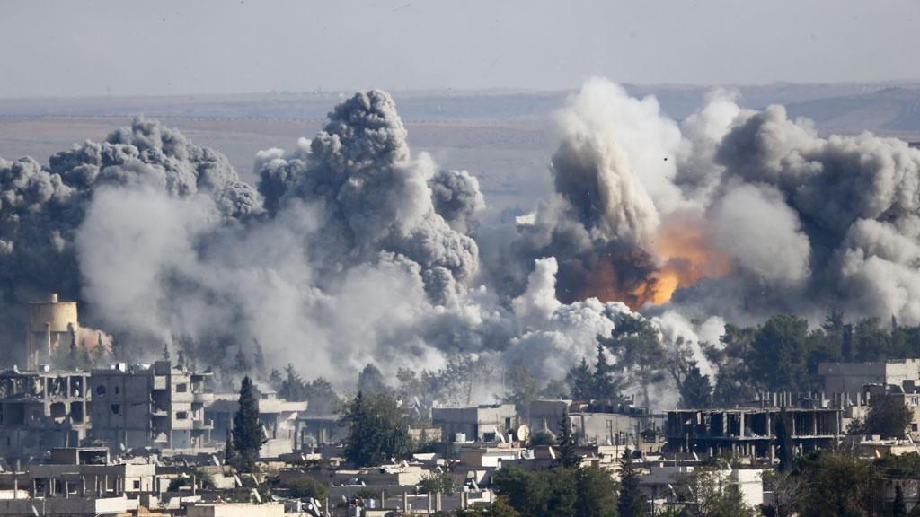 Coalition air strikes rock Kobani (Reuters)
