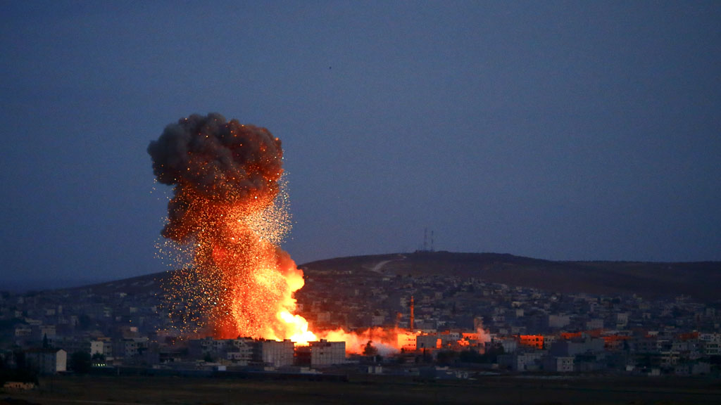 Flames and smoke rise from Kobani (Reuters)