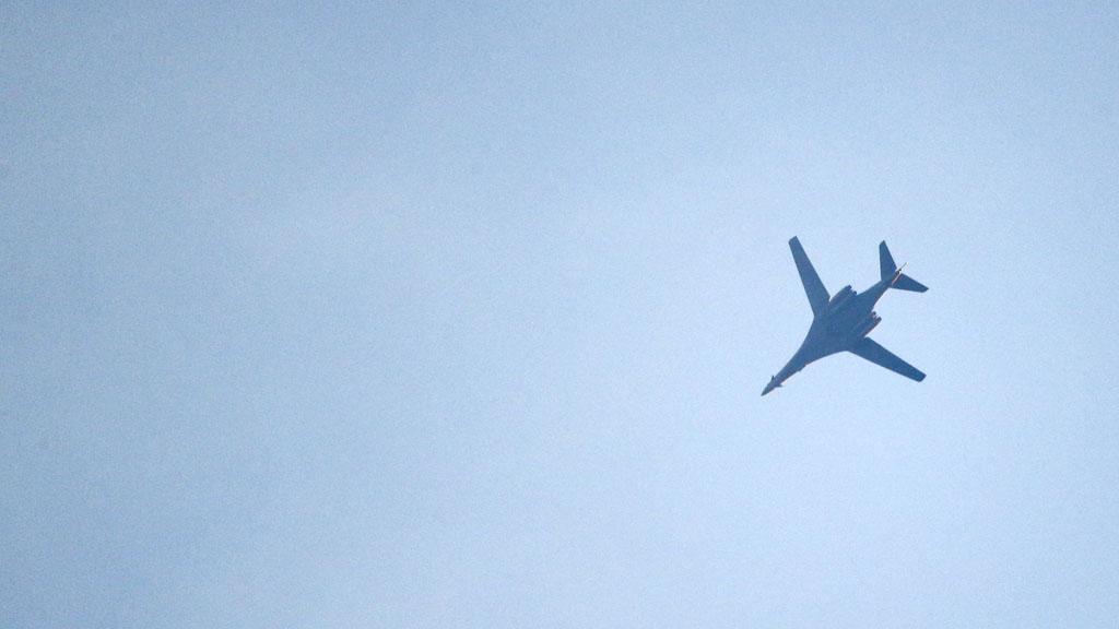 Coalition jet circles above Kobani (Reuters)