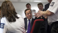 David Cameron and UK Border Agency officials