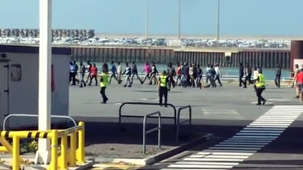 Migrants attempt to storm Calais ferry