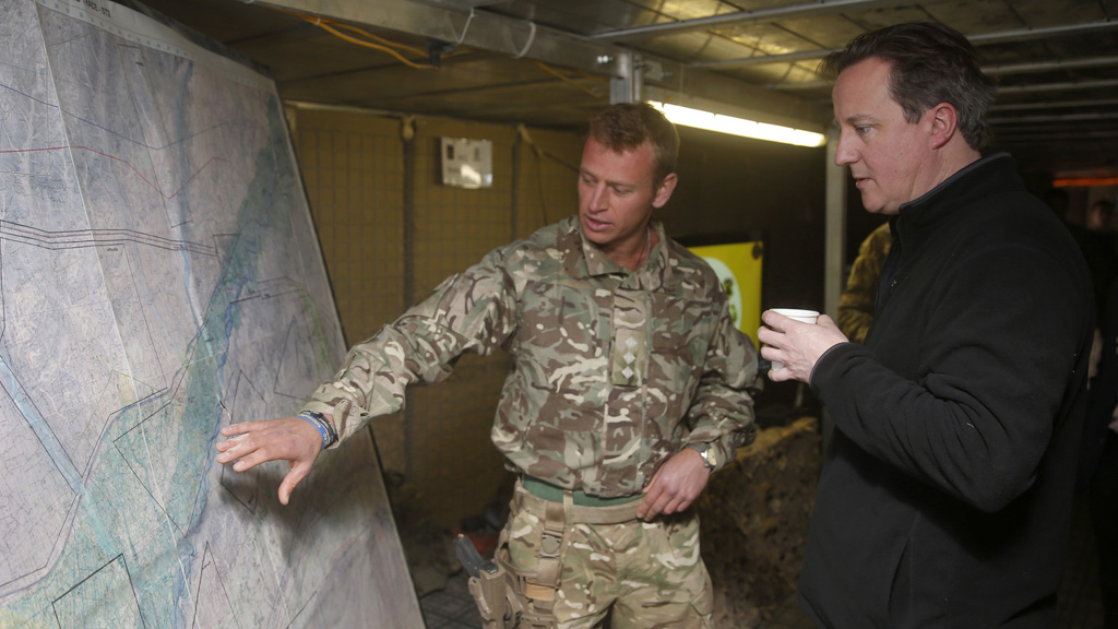 David Cameron at military briefing (Reuters)