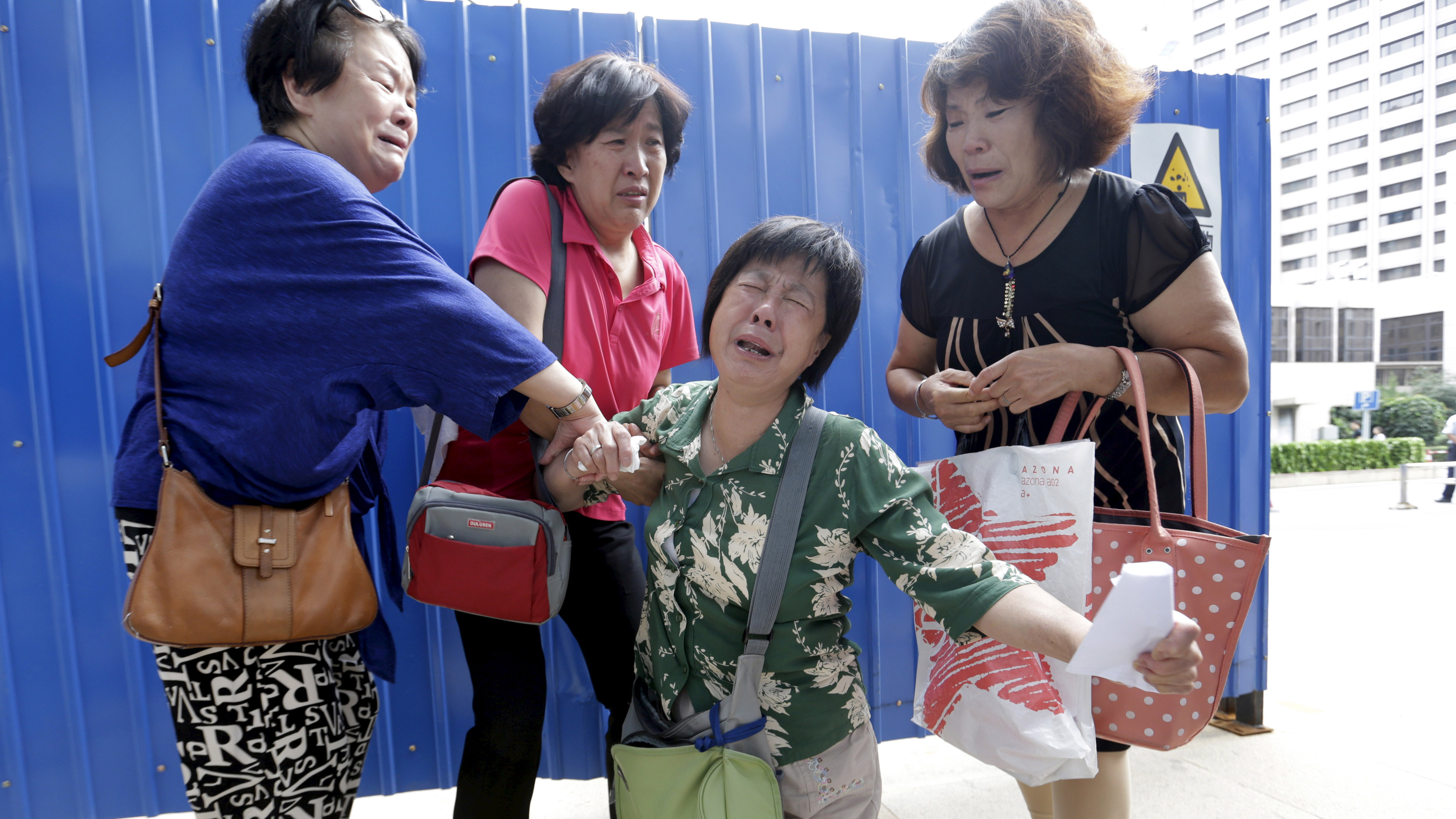 Grieving relatives in Beijing (Reuters)
