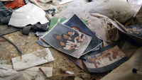 Family photos amid the rubble of a home in Ghouta (Getty)