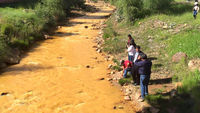 River water yellow with pollution (courtesy Russell Begaye)