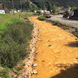 Yellow polluted river water (Courtesy Russell Begaye)