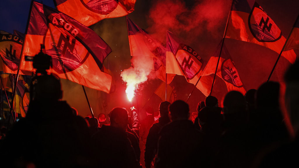 Activists fly the flag of the Azov Battalion (Reuters)