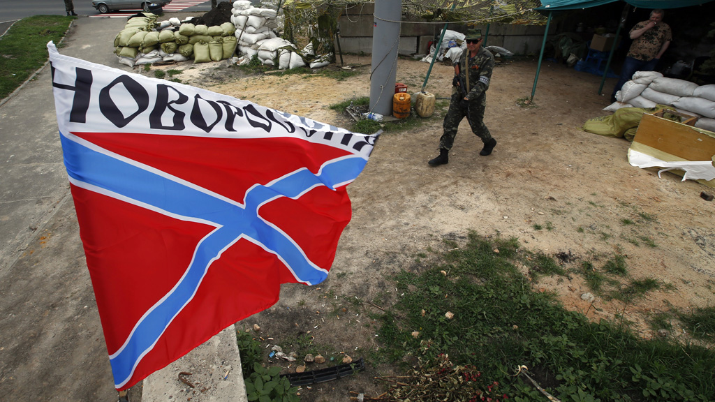 Separatists fly the flag of Novorossiya at a checkpoint in eastern Ukraine (Reuters)