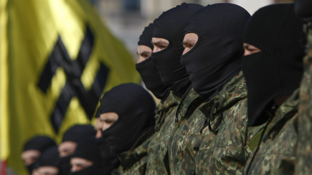 Azov Battalion volunteers fly the Wolfsangel flag (Reuters)