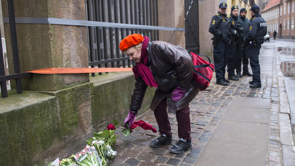 A well-wisher lays flowers near the synagogue in Copenhagen (Getty)