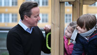 Prime Minister David Cameron with nursery school children (Reuters)