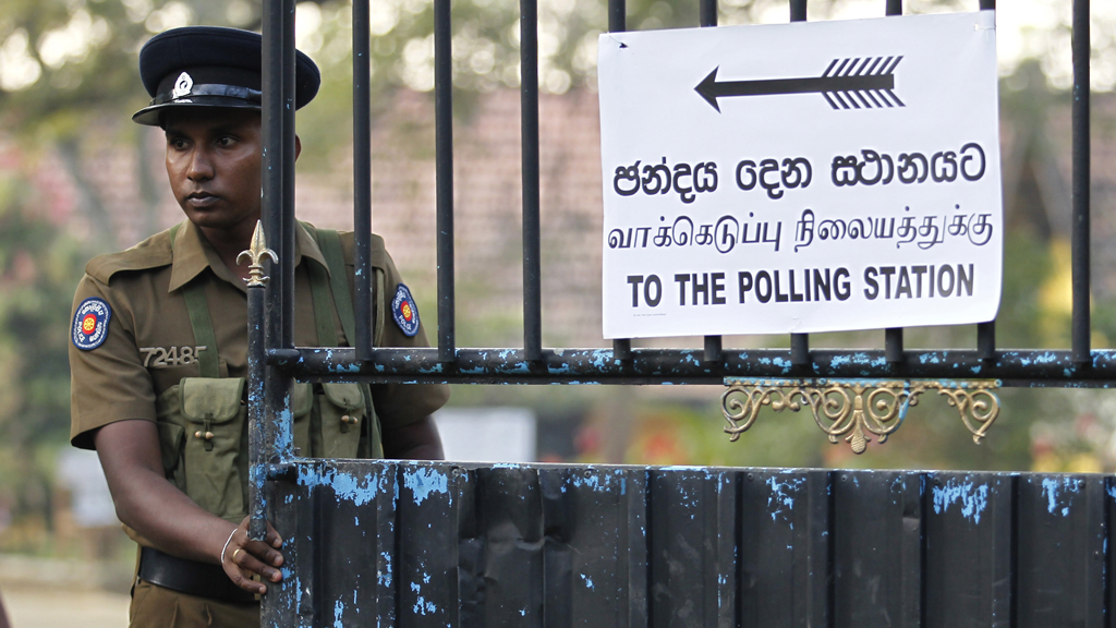 A police officer outside a Sri Lankan polling station (Reuters)