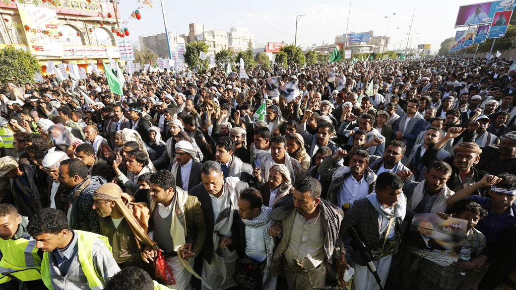 Houthi followers show their support to the group in a march in Sana'a