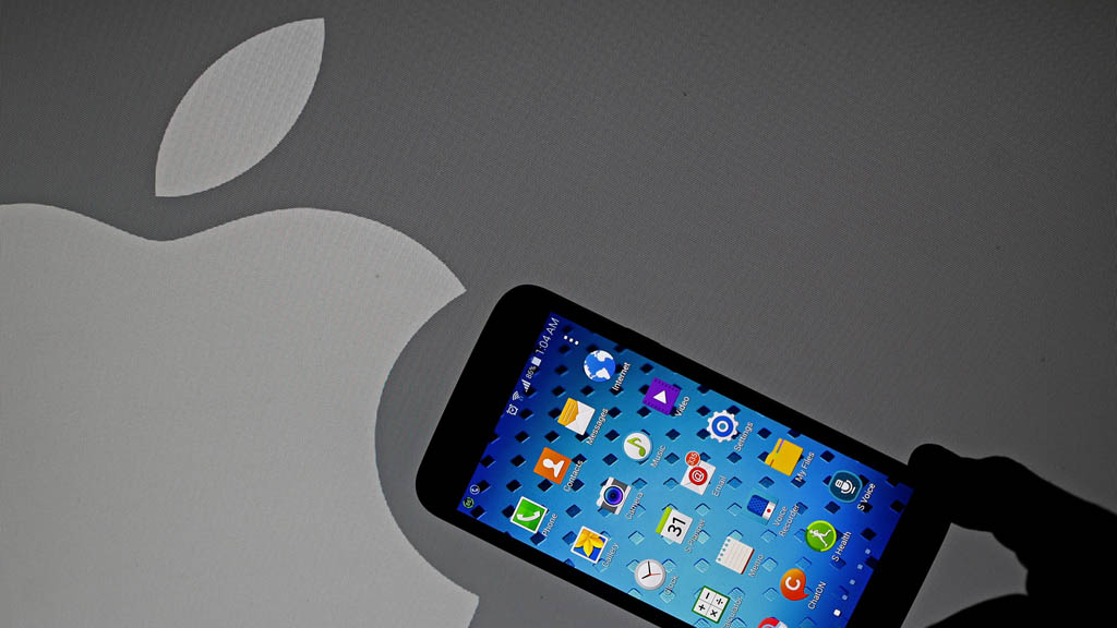 Apple logo and an iPhone (Reuters)