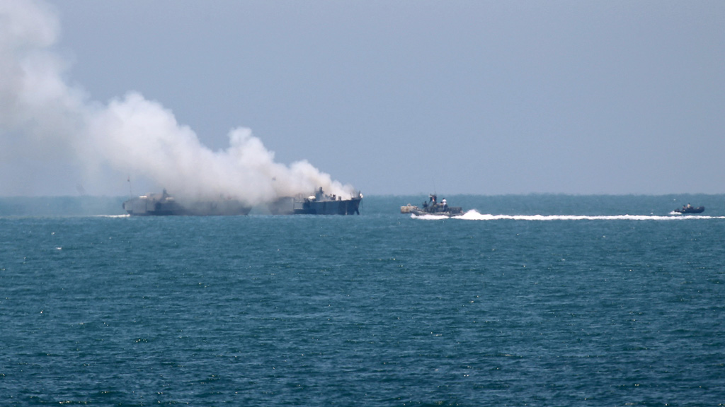 Smoke rising from an Egyptian naval vessel