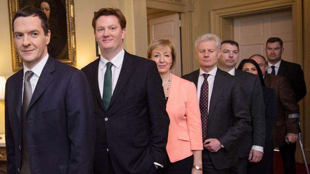 George Osborne poses with his Treasury team (Reuters)