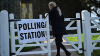 Sign for a polling station on a five-barred gate (Getty)