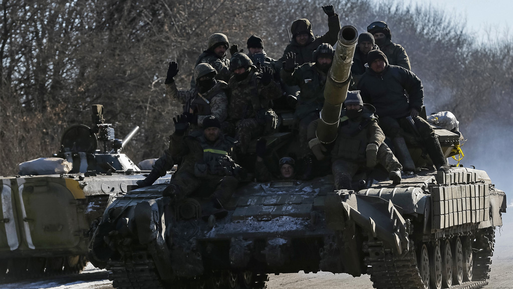 Ukrainian soldiers on a tank as they leave Debaltseve (Reuters)
