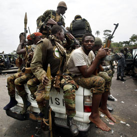 Forces loyal to Ouattara on the outskirts of Abidjan (reuters)