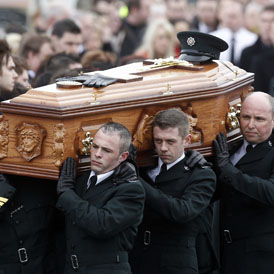 PC Ronan Kerr's coffin is carried my police in Northern Ireland. He was killed by a bomb in Omagh on Saturday (Reuters)