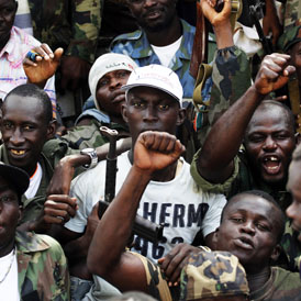 Ouattara supporters celebrate his victory (Reuters)