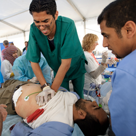 Inside Misrata: hospital staff try to resuscitate an injured man. (Getty)