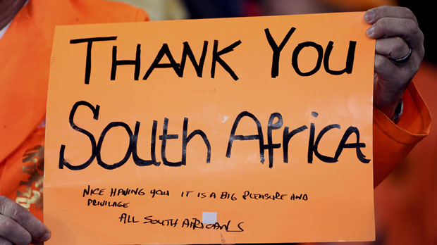 A fan holds up a sign before the start of the 2010 World Cup final soccer match at Soccer City stadium (Reuters)