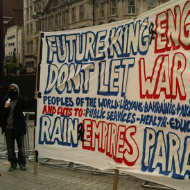 A small group of peaceful demonstrators were allowed to unfurl a banner in the square reading: