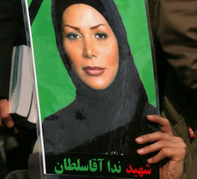 An Iranian opposition supporter holds a picture of Neda Agha Soltan. (Getty)
