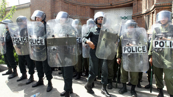 Iranian riot police stand guard in Tehran. (Getty)