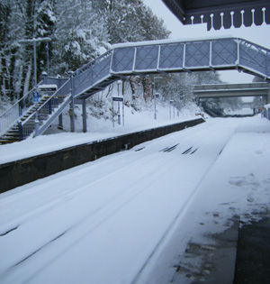 Railway station covered in snow