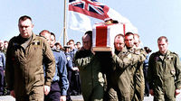 The ship's company of HMS Ark Royal pay their last respects to three of their colleagues during a repatriation ceremony in the Gulf March 28, 2003. Seven aircrew officers of 849 Squadron A flight died