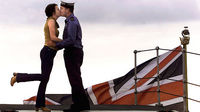 Air Engineer Craig Russell kisses his girlfriend goodbye on the deck of the HMS Ark Royal at Rosyth