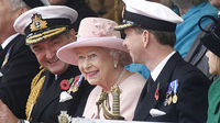 Britain's Queen Elizabeth sits with Admiral Trevor Soar, Commander-in-Chief Fleet of the Royal Navy and Captain Jerry Kyd, the commander of HMS Ark Royal, during a visit to the ship in Portsmouth. (Cr
