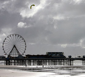 A man flies a kite on Blackpool beach, near where Shale gas has been discovered.