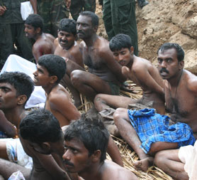 Tamil men pictured with soldiers in Sri Lanka