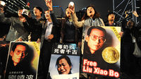 Supporters of Nobel Peace Prize winner Liu Xiaobo (Image: Reuters)