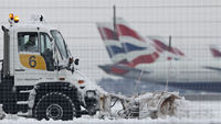 A snow plough is driven by a worker at Heathrow Airport in west London December 19, 2010. Reuters.