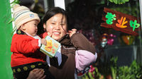 What does she know? A mother and child in Beijing (Getty)