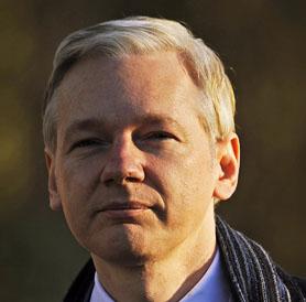 Julian Assange entering court (Getty)