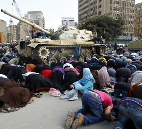 Morning prayers before protests swell across city (Reuters)