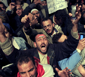 Tahrir Square is mobbed as protesters show their anger that Mubarak is staying in power (Reuters)