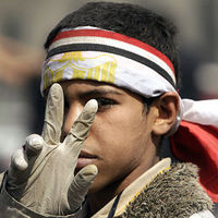 pAn anti-government protester gestures inside Tahrir Square in Cairo (Reuters)