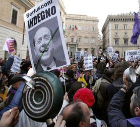 Protesters in Rome call on Silvio Berlusconi to resign (Reuters)