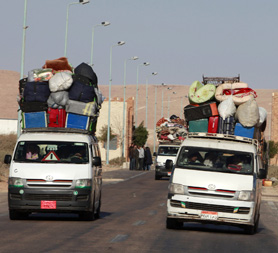 Refugees leaving Libya (R)