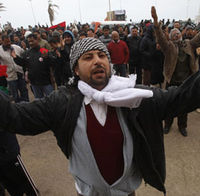 Protesters against the Libyan leader Gaddafi chant slogans during a demo in Benghazi. (Reuters)