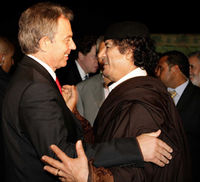 Tony Blair shakes hands with Colonel Gaddafi. (Getty)