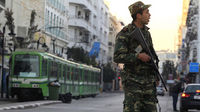 A Tunisian army soldier patrols downtown in Tunis (Reuters)