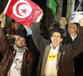 Egyptian protesters wave the Tunisian flag in Cairo (Reuters)