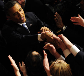 US President Barack Obama is greeted following his State of the Union address. (Getty)